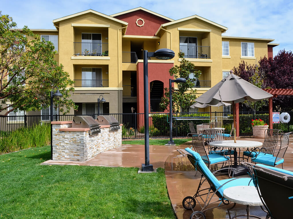 Outdoor Gathering Space with BBQ Grills and Outdoor Seating at Sterling Village Apartment Homes, 88 Valle Vista Avenue, 94590