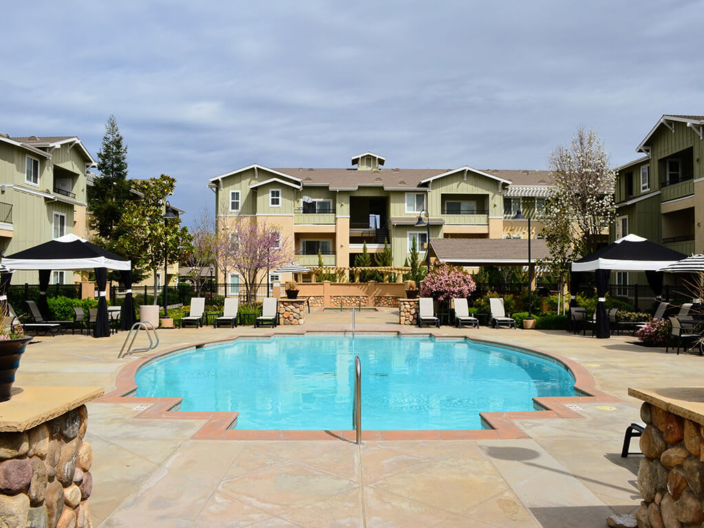 Swimming Pool with Lounge Chairs at Waterstone Apartment Homes, Tracy, California