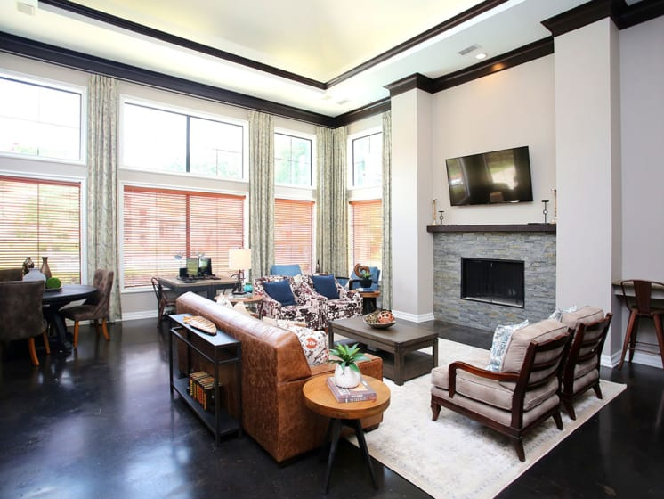 Community Lounge With Ample Seating and a TV at Lost Spurs Ranch Apartments in Roanoke, Texas