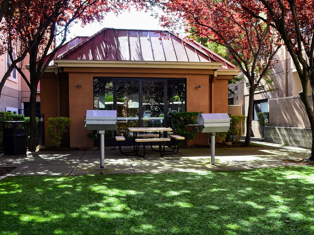BBQ Area with Picnic Tables at Del Norte Place Apartments, CA, 94530