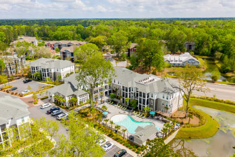 Aerial view of Proximity Charleston's apartment buildings and pool