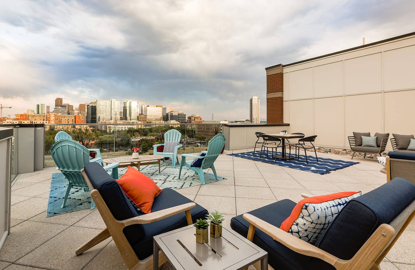 Lounge Furniture And Outdoor Dining Table With A Stunning Skyline Backdrop at Centric LoHi by Windsor, CO, 80211