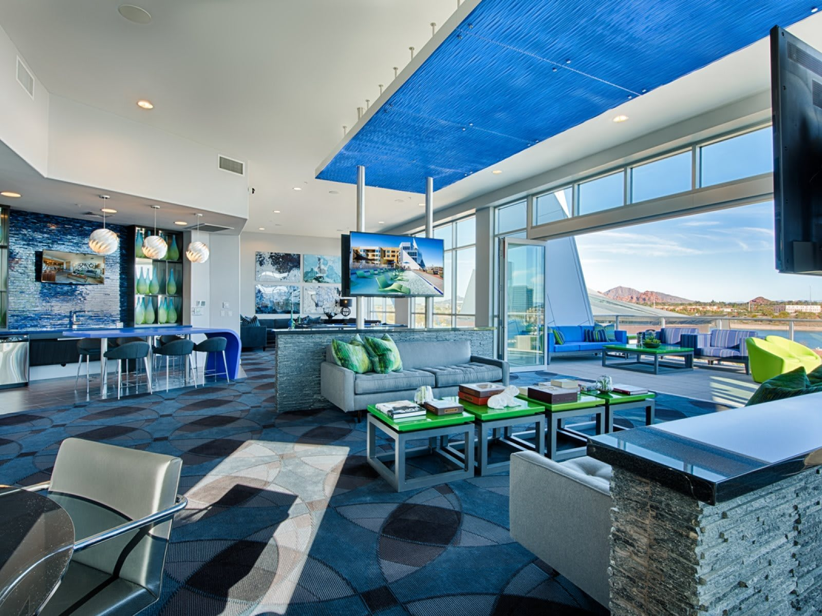 open air sky lounge with TVs