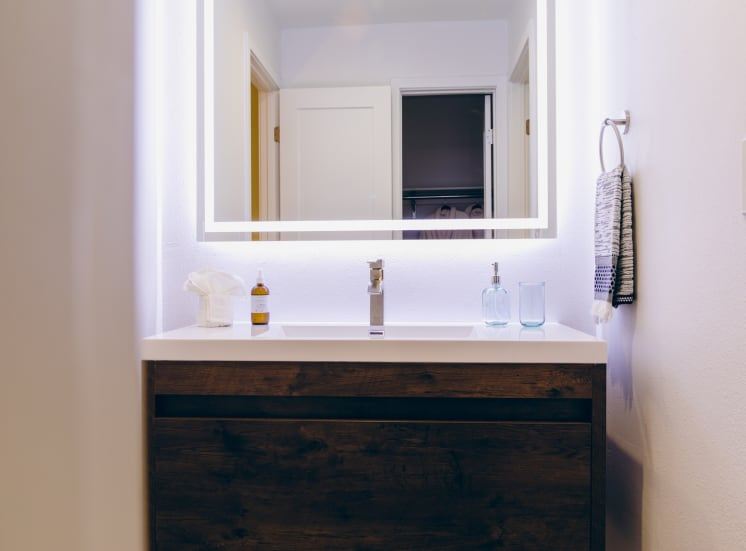 Single vanity area with led mirror lights. Not all features are available in every apartment.