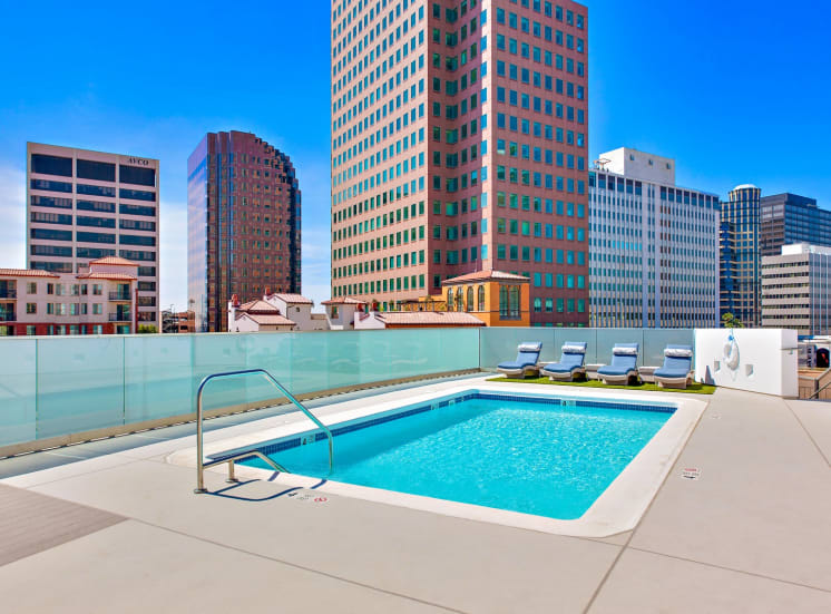 Resort-style rooftop pool with lounge and a great views