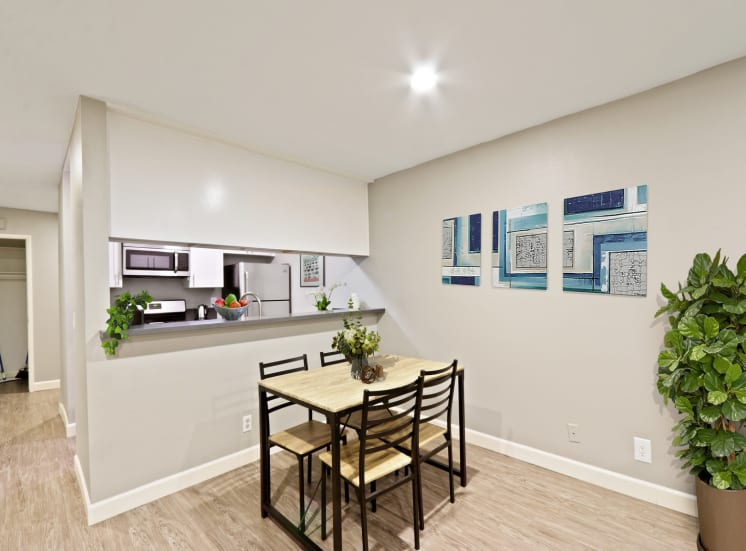 Dining area with wood style floors, recessed lighting