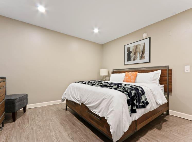 Bedroom with recessed lighting, wood inspired floors