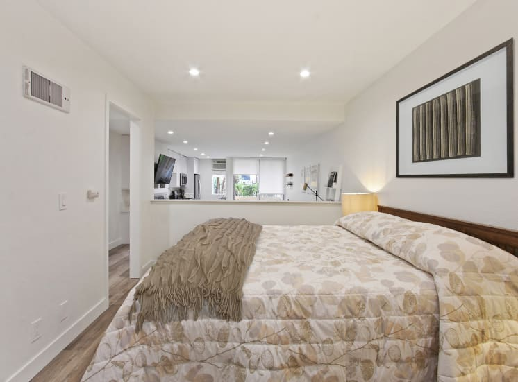 Sleeping area of a one bedroom suite, wood-style floors throughout