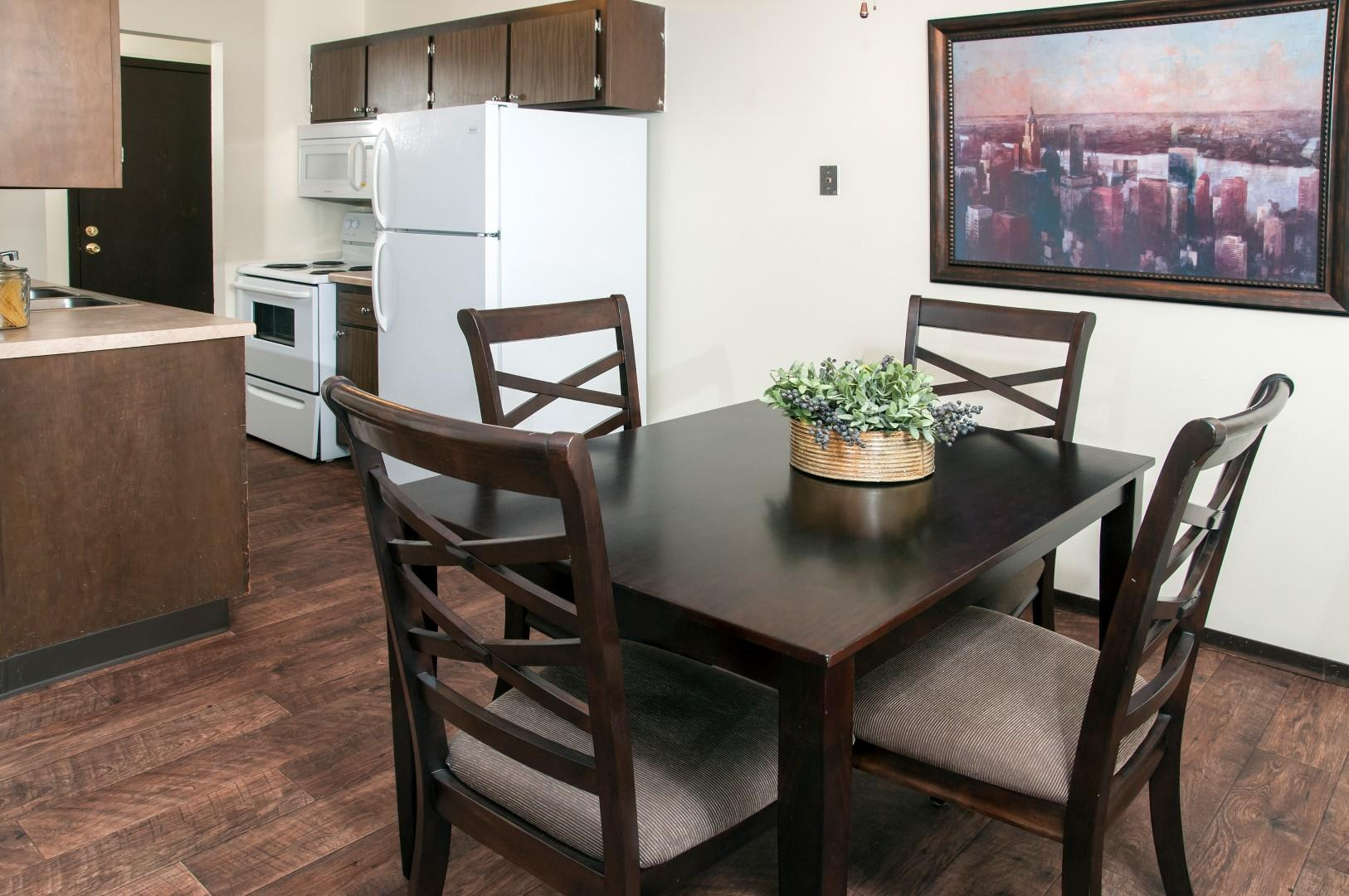 Hardwood Floors in Dining Room and Kitchen of Apartments in Burnsville, MN