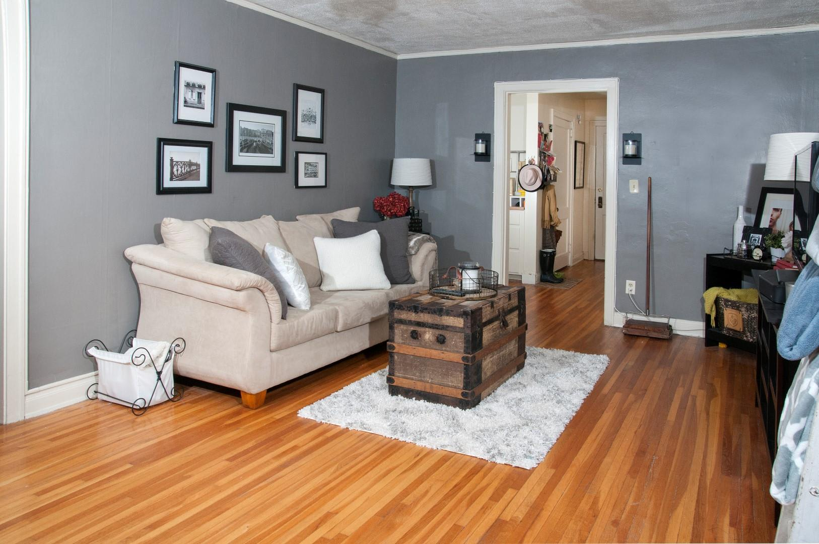 Spacious Living Room with Light Hardwood Floors at 3500 Dupont