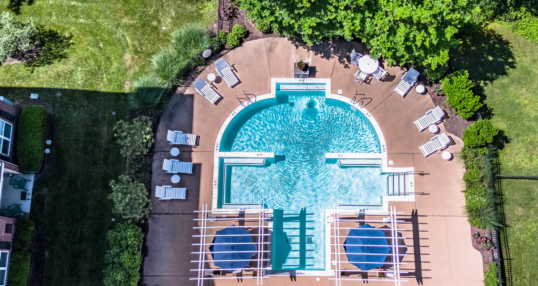 Seasonal pool and tanning deck within steps from your apartment backdoor. Enjoy luscious green space and the beauty of nature every day at Alexander Heights.