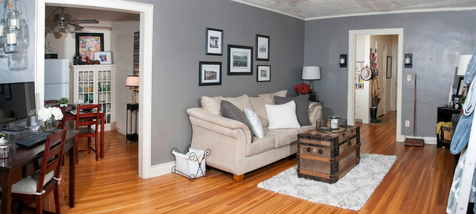 Open Livingroom with Grey Walls and White Trim at 3500 Dupont Apartments