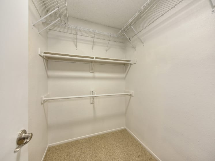 Extended Closet with White Walls, Shelves and Shelves
