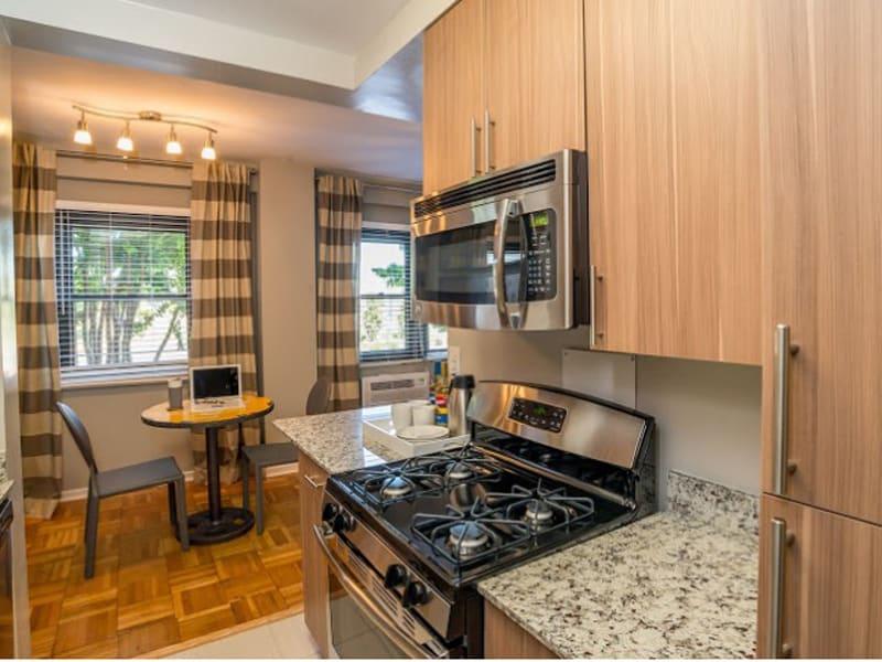 Modern kitchen with stainless steel appliances at Bridgeyard in Alexandria, VA