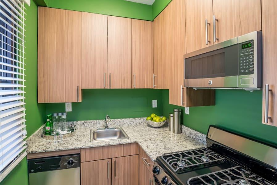 Modern kitchen with light wood cabinets at Bridgeyard in Alexandria, VA
