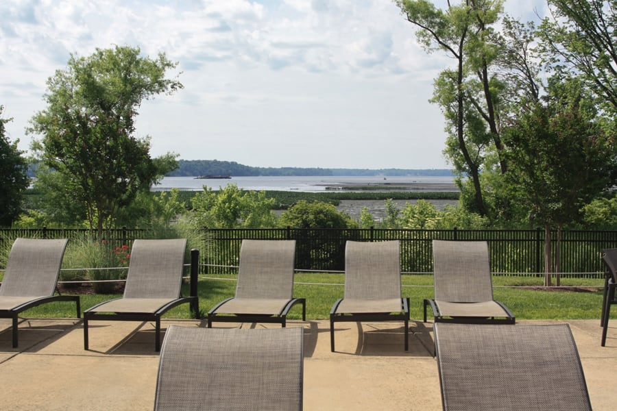 Lounge chairs located by outdoor pool at Bridgeyard in Alexandria, VA