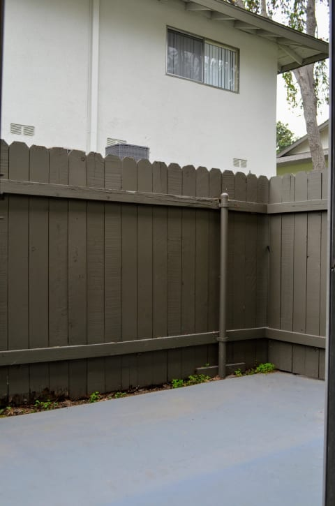 Cover back fence with contemporary style wood at Terramonte Apartment Homes, Pomona, California