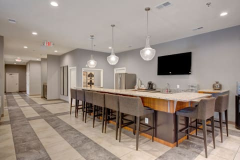 Clubhouse common area kitchen with bar seating