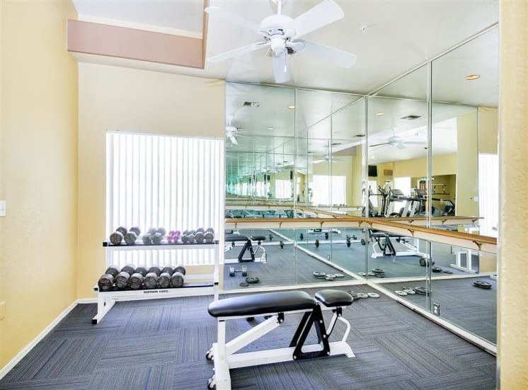 Weight training at the fitness center, gym at Ventana Apartment Homes in Central Scottsdale, AZ, For Rent. Now leasing 1 and 2 bedroom apartments.