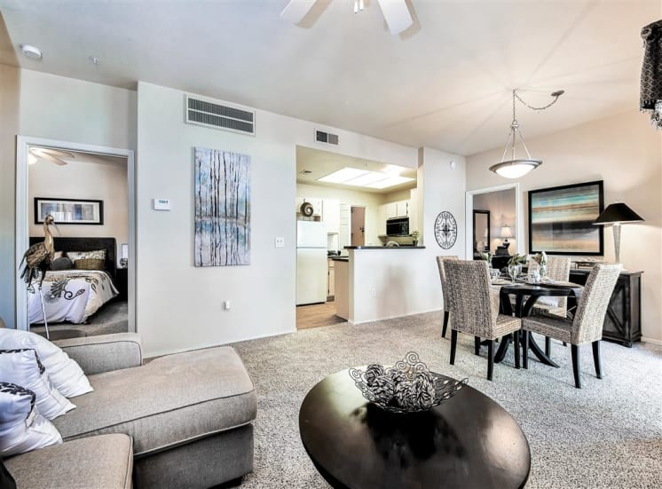 Kitchen open to entertaining area at Ventana Apartment Homes in Central Scottsdale, AZ, For Rent. Now leasing 1 and 2 bedroom apartments.