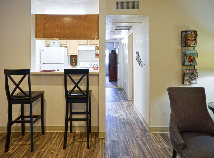 Dine at counter bar in kitchen, living room 1, 2 and 3 bedroom apartments available, For Rent at Pavilions at Pantano in Tucson, AZ.