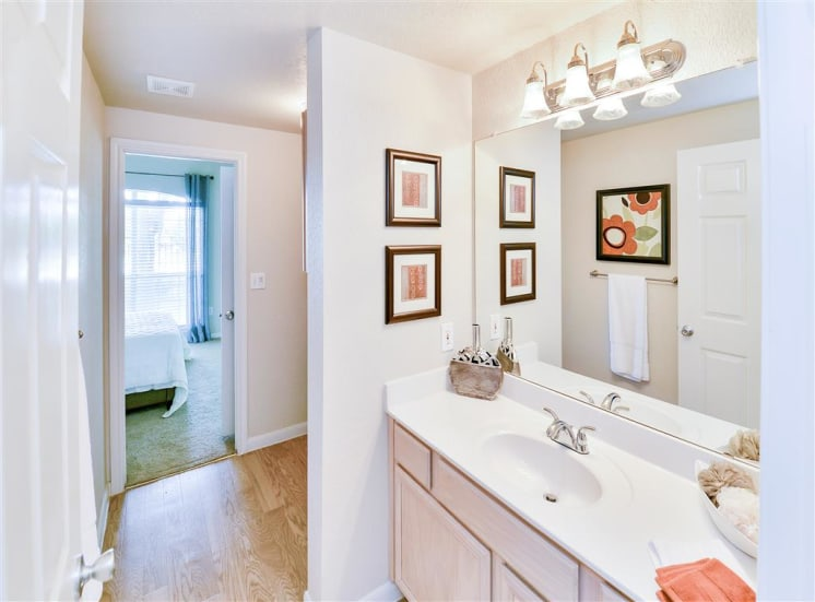 Mirrored vanity bathroom at Bentley Place at Willow Bend Apartments in West Plano, TX, For Rent. Now leasing 1, 2, and 3 bedroom apartments.