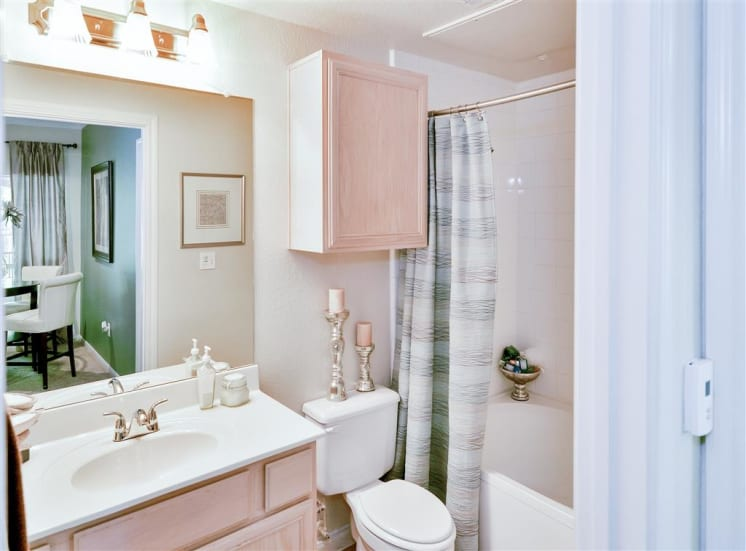 Bathroom storage at   Bentley Place at Willow Bend Apartments in West Plano, TX, For Rent. Now leasing 1, 2, and 3 bedroom apartments.