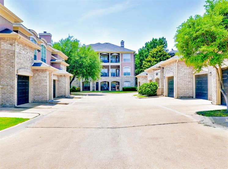 Direct access garages at Bentley Place at Willow Bend Apartments in West Plano, TX, For Rent. Now leasing 1, 2, and 3 bedroom apartments.