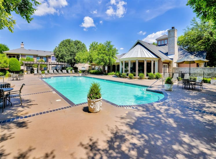 Resort pool view at Bentley Place at Willow Bend Apartments in West Plano, TX, For Rent. Now leasing 1, 2, and 3 bedroom apartments.