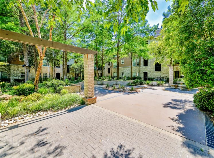 Lush grounds at Bentley Place at Willow Bend Apartments in West Plano, TX, For Rent. Now leasing 1, 2, and 3 bedroom apartments.