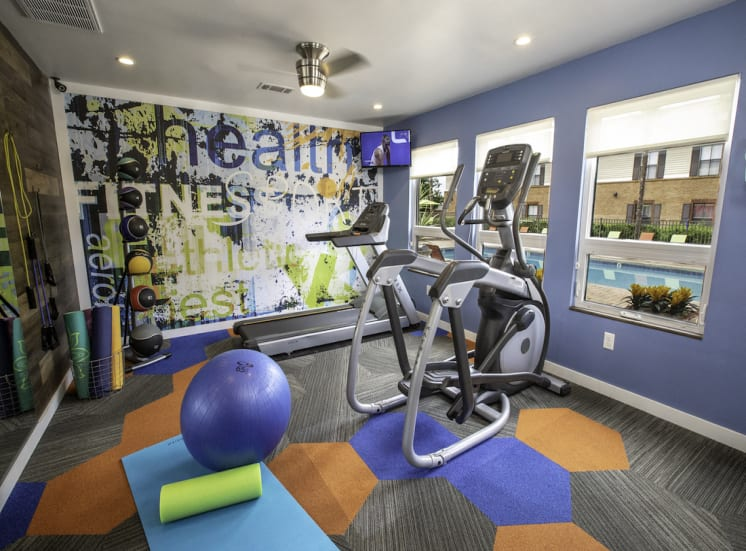 colorful fitness center with cardio and weight training equipment