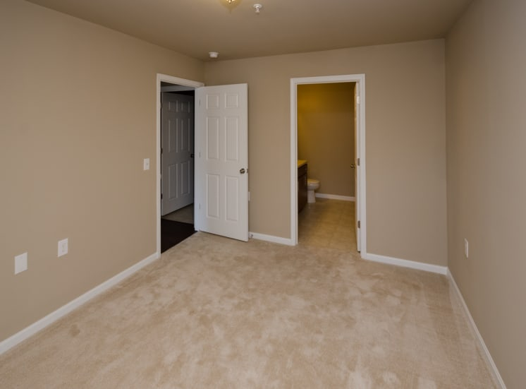 bedroom with carpet in apartment