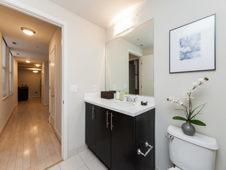 Renovated Bathrooms With Quartz Counters at The Woodward Building Apartments, Washington, DC