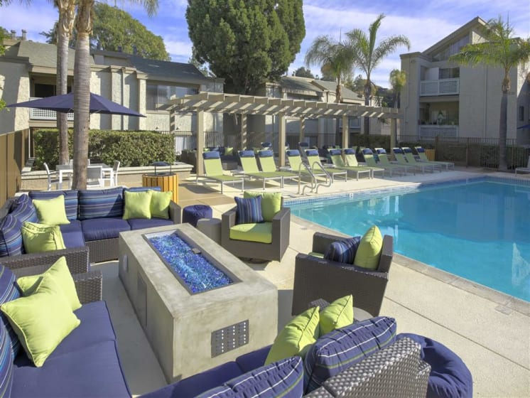 Poolside Fireplace with Seating Arrangement at The Verandas Apartments, West Covina, California