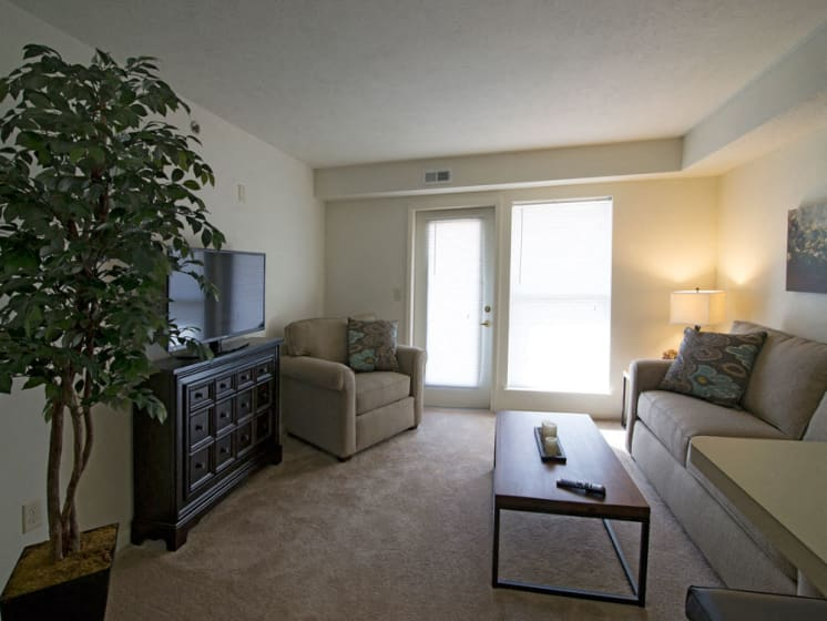 Living Room with access to patio or balcony at Stoney Pointe Apartment Homes, Wichita, Kansas