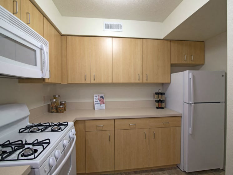 Kitchen with microwave at Stoney Pointe Apartment Homes, Wichita, KS, 67226