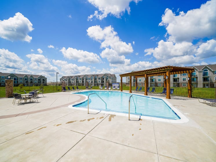 Outdoor Sundeck, Pool, and Pergola at Stoney Pointe Apartment Homes, Wichita, KS