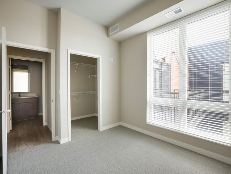Bedroom With Large Window and Closet at The M on Hennepin in Minneapolis, MN