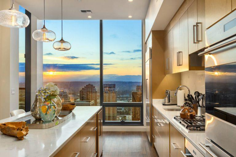 Modern Kitchen With Stainless Steel Appliances And Double Door Refrigerators at Two Lincoln Tower, Bellevue, WA