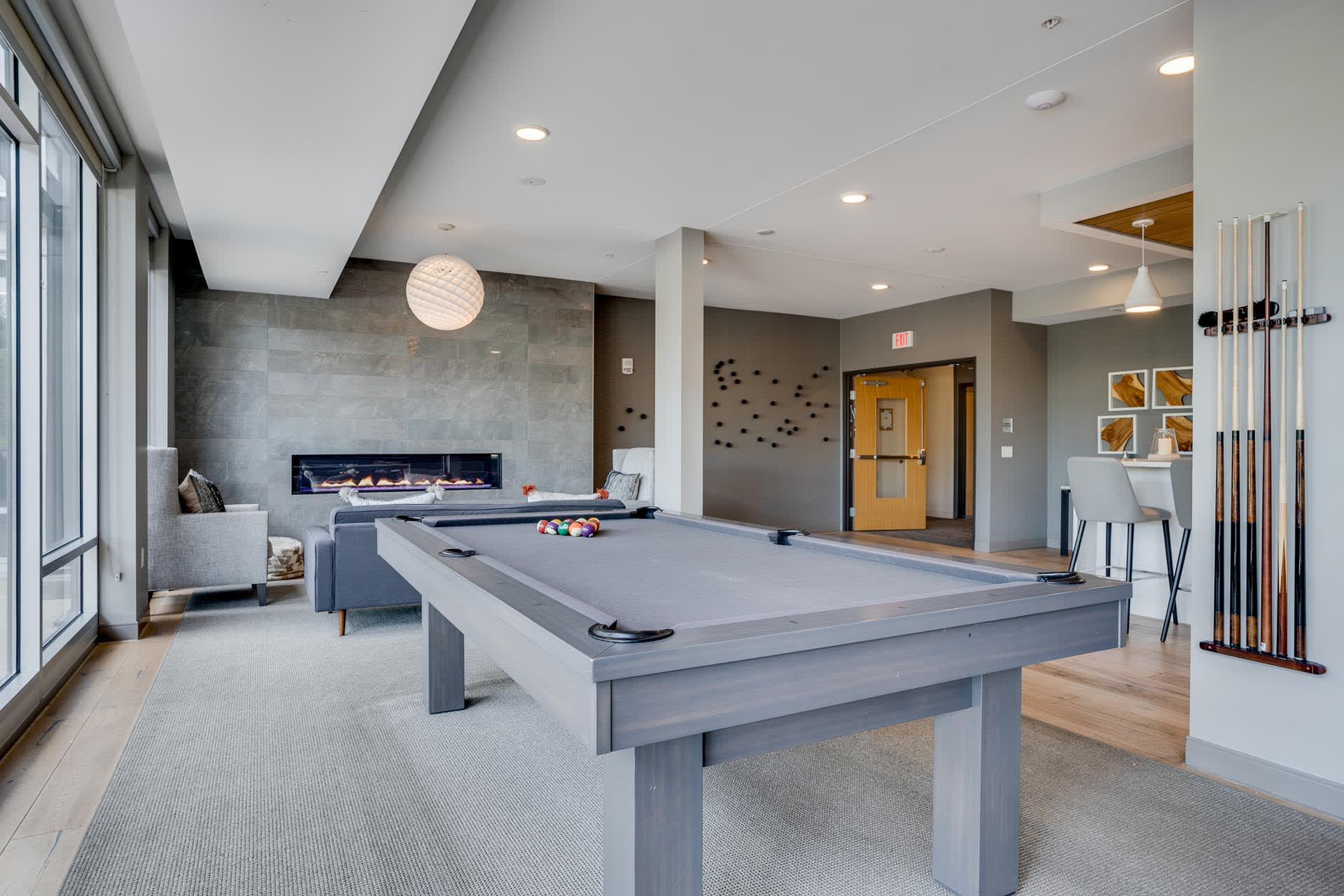The Club Room features a pool table, big screen TV, and a gourmet kitchen