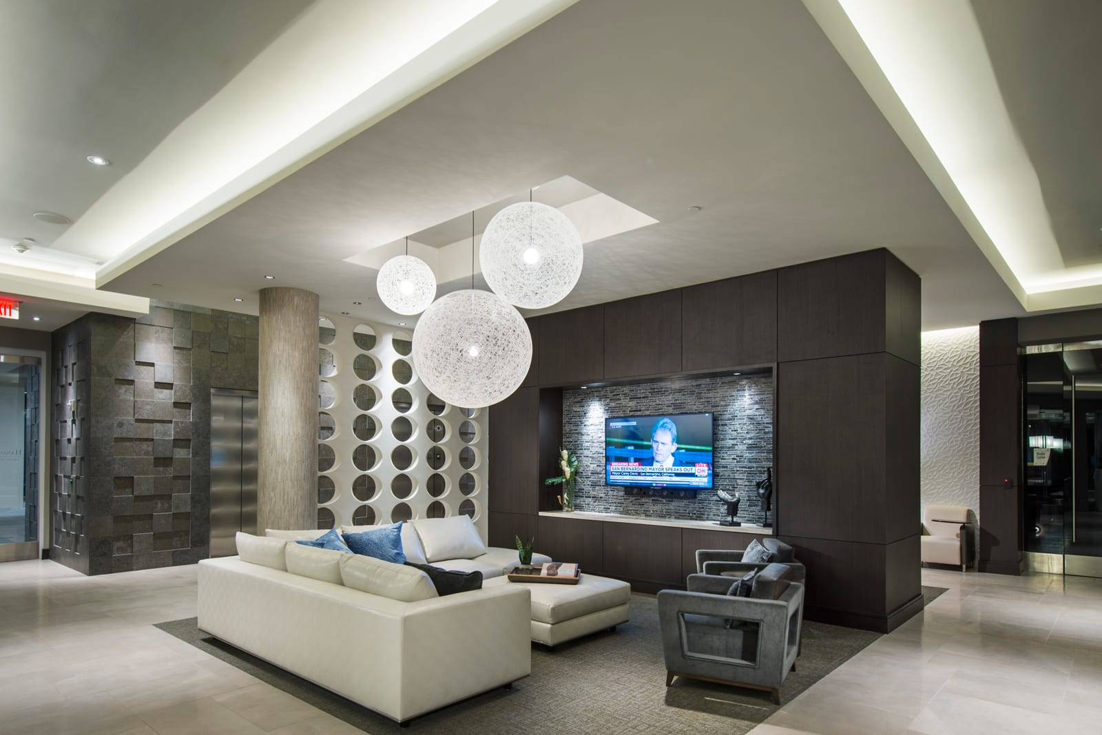 Grand Lobby with Television at 1000 Grand by Windsor, 90015, CA