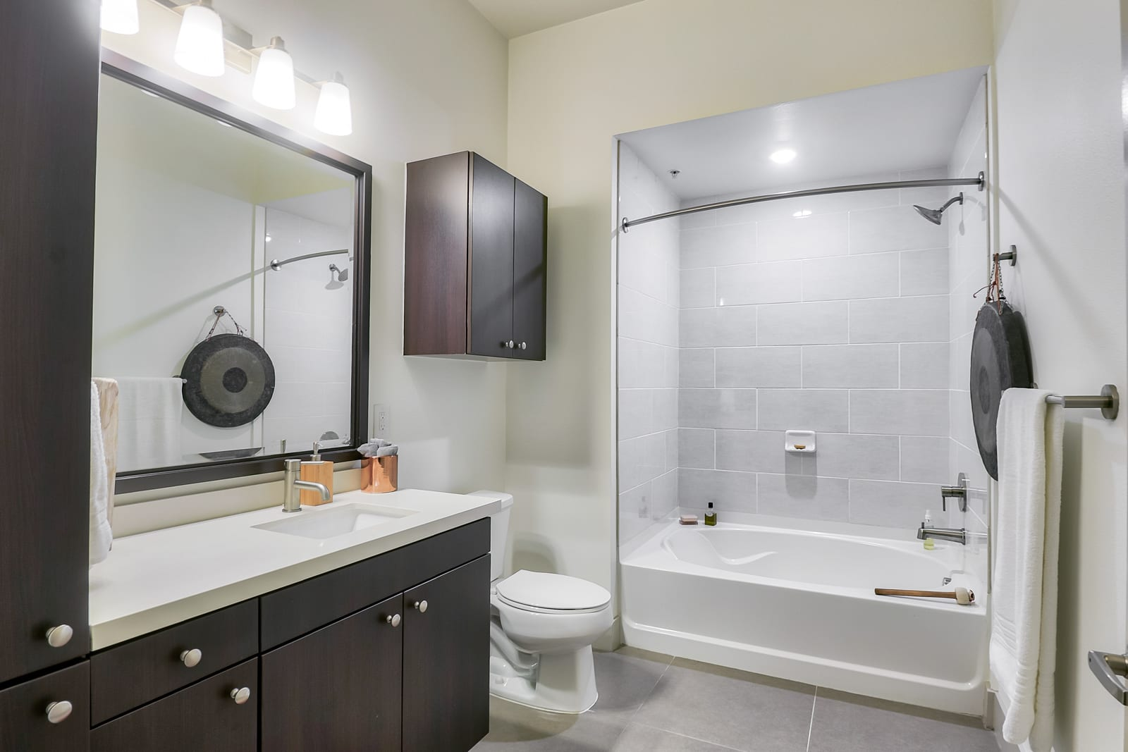 Spacious Bathrooms with Granite Countertops at 1000 Grand by Windsor, 90015, CA