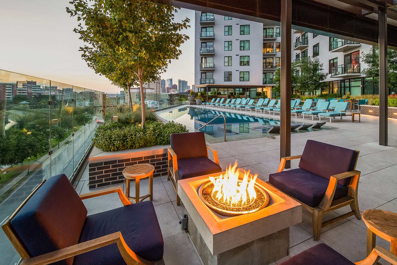Poolside Entertainment Area With Firepit at 1000 Speer by Windsor, Denver, Colorado