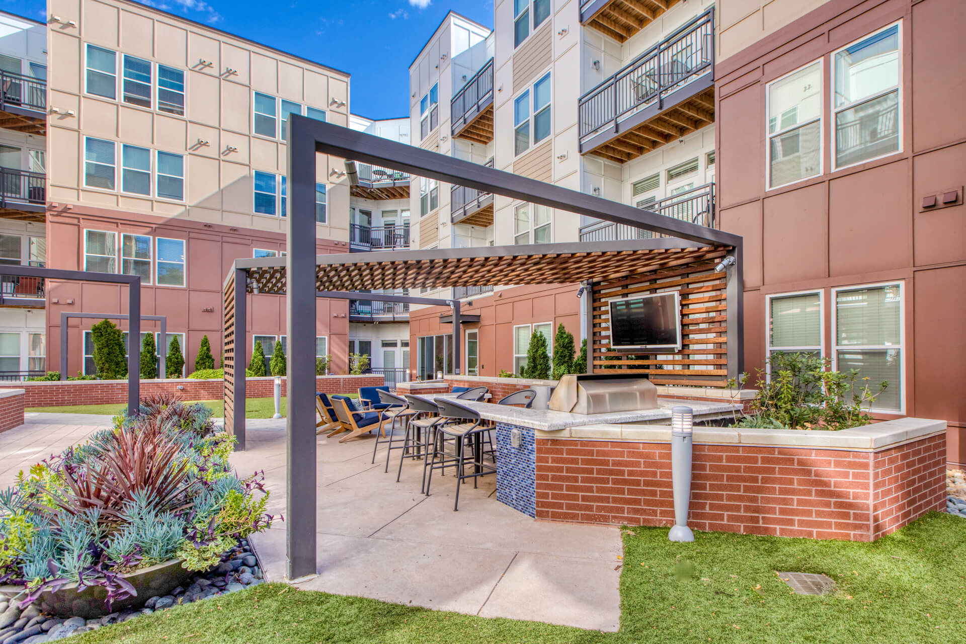 Outdoor Grill With Seating Area at Centric LoHi by Windsor, Denver