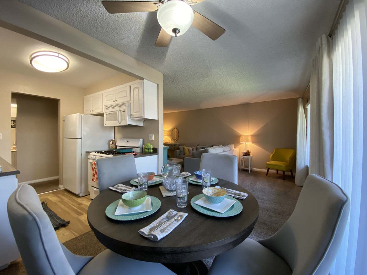 Dining Room With Ceiling Fan at Stoneridge Apartment, California