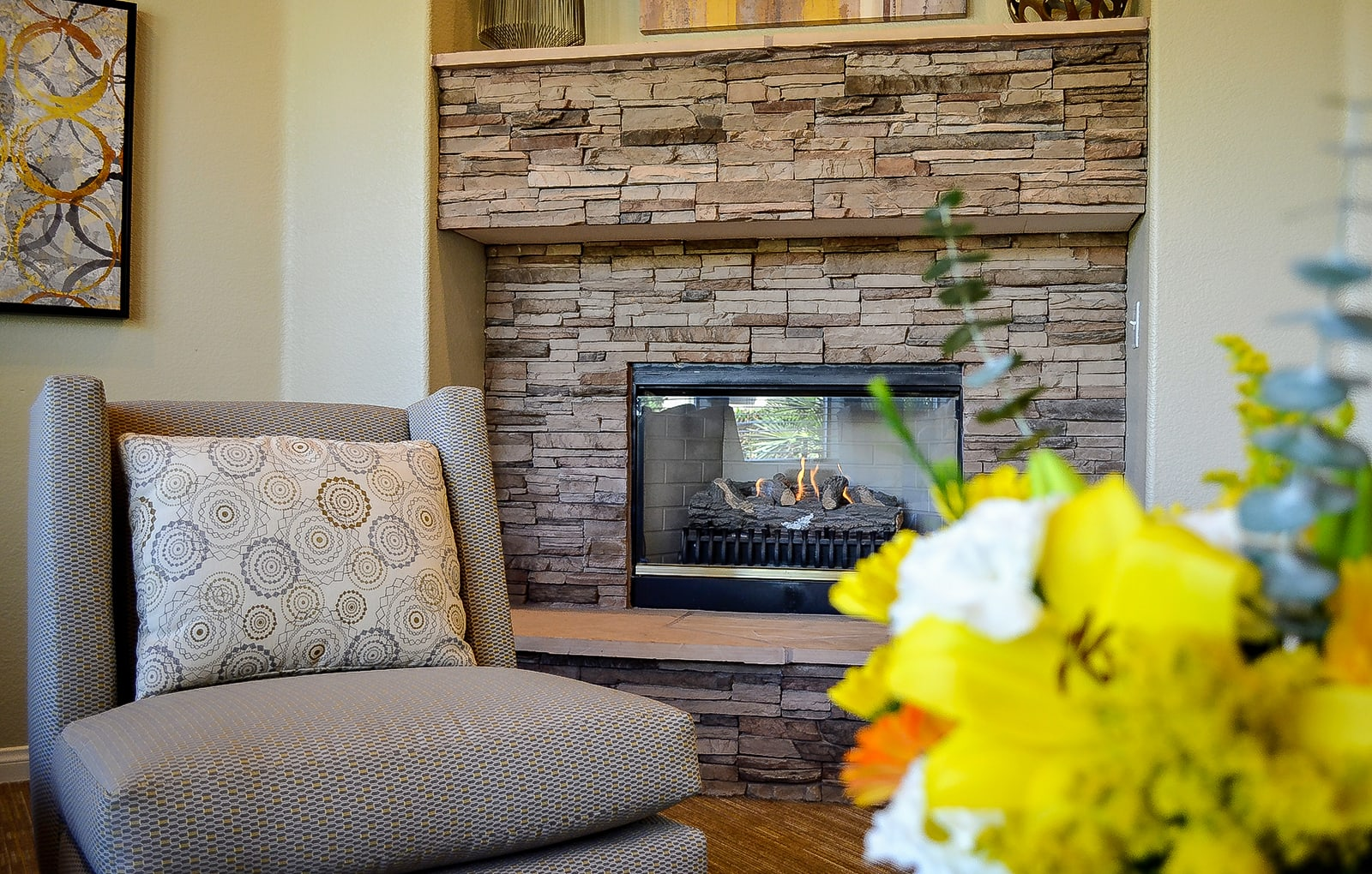 Leasing Office Fireplace and Chair at Tuscany Ridge Apartments, 92591, CA