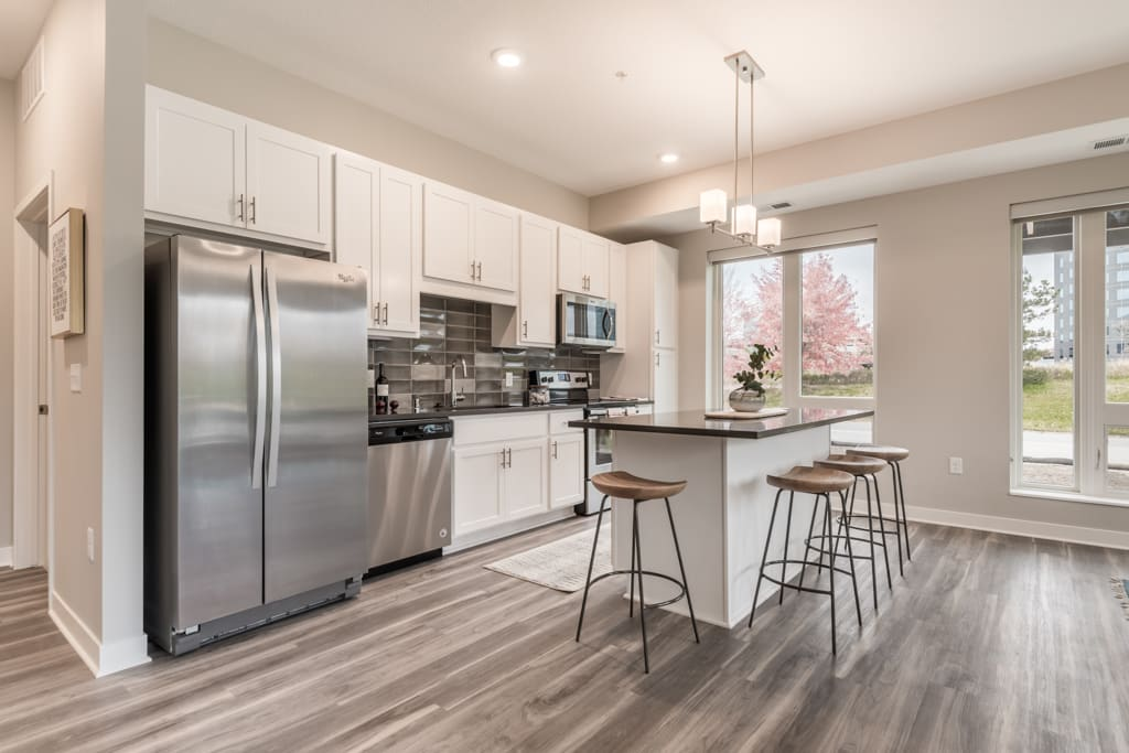 Interiors- Design A-White cabinets and dark countertops-The Preserve at Normandale Lake