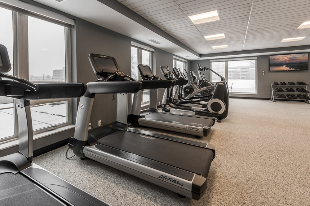 Gym with built-in TVs in the treadmills