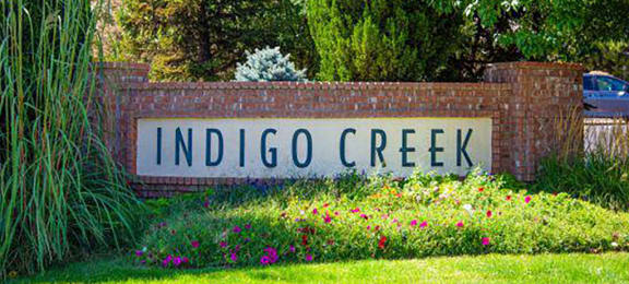 Welcoming Property Sign at Indigo Creek Apartments, Colorado
