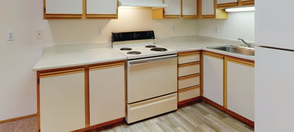 Kitchen cabinets and stove at Auburn Court in Auburn WA